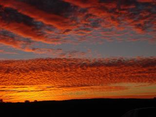 Sit on the deck, enjoy a glass of wine and  watch a sunset like this one. - Maric Park Cottages