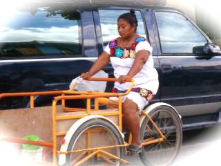 Modern vehicles mix with locals on bikes and tricicletas! - KAREN CHRISTNER