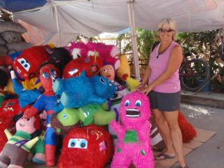 Karen with piñatas galore...which one to buy for our grandson??? - KAREN CHRISTNER
