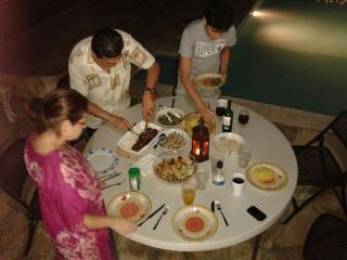 dinner at the pool in our house at Managua, Nicaragua - Pilar Garcia
