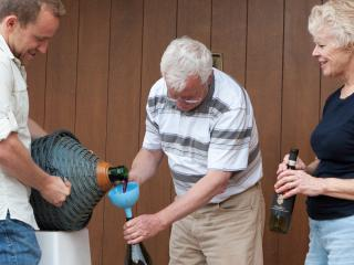 Max (left), Fabrizio (center), Nora (right). Bottling some wine in front of the house. - Max & John