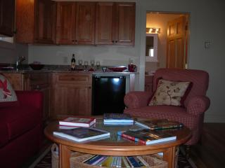 Kitchenette & living room round table. - The Moxie Oceanfront Luxury Cottage