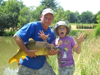 brother in law and nephew fishing in france - JOANNE KIRK