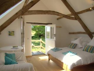 Polly's Bower Bedroom, with lovely oak floors, double ended bathtub and power shower - Lantallack Getaways