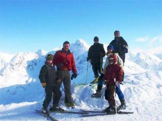 Skiing group with instructor - Grzegorz Buczkowski Innkeeper and ski instructor