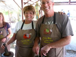 Learning to cook Thai style in a cooking class in Bangkok earlier this year - Janice Shallin & Bill Vickers (wife & husband)