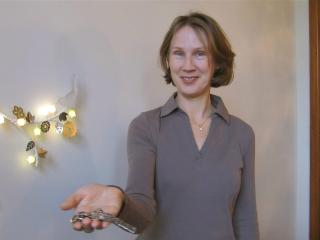 Monika in aslan!place apartment, ready with apartment keys to welcome you - Julia and Tarkan