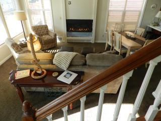 Beautiful living room with fireplace and large screen - DON & KAY Perepchuk
