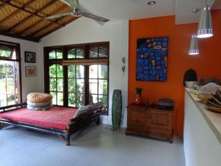 Day bed next to fully opening windows from which to have a massage, rest, read, relax - Angel Villa Bali