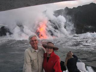 Brad and Beth viewing fresh lava from a small boat - Beth Mccormick