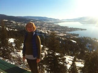 Aileen Houston on the KVR Trail with Okanagan Lake in background - Aileen Houston