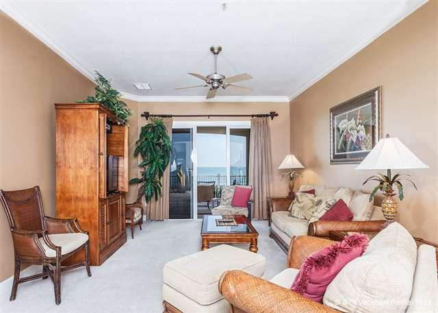 Bask in the sunlight in our tropically elegant living room - 634 Cinnamon Beach Resort, 3rd Floor Ocean Front, 5 Star Condo - Palm Coast - rentals
