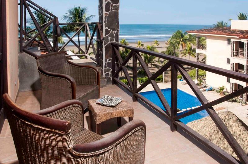 Ocean and pool views from the main balcony - Bahia Encantada 4J 4th Floor Ocean View - Jaco - rentals