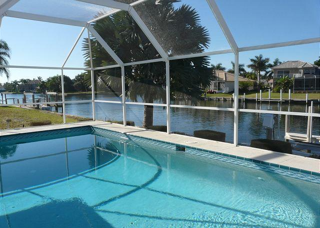 Stylish waterfront home with all-day sun and short walk to shopping a dining - Image 1 - Marco Island - rentals