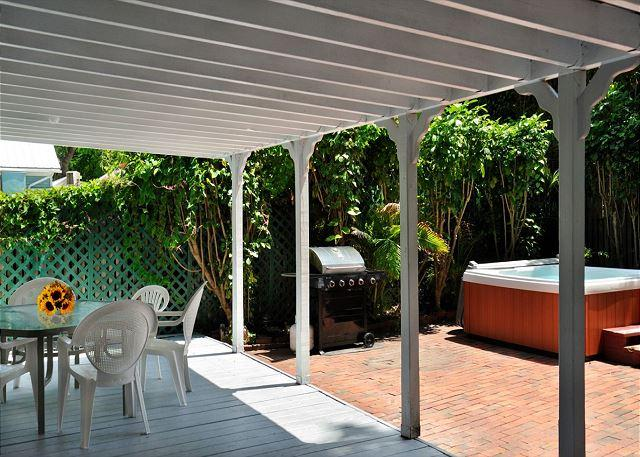 "Deck Area With Outdoor Furniture, Jacuzzi, and Grill - ""HEMINGWAY'S VIEW"" - Great Location, 3 BR 2 Bath, Decked Viranda and Hot Tub - Key West - rentals"
