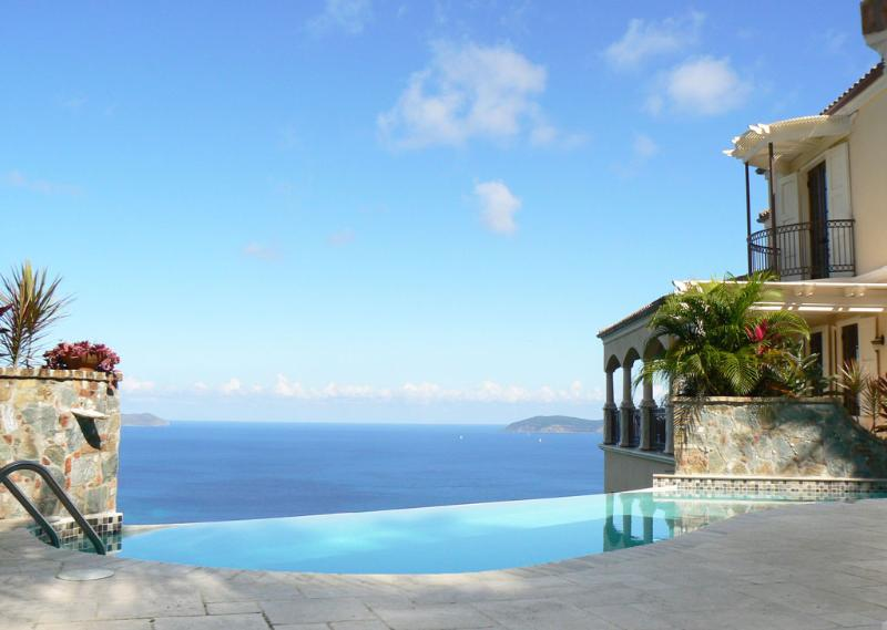 The villa's pool framed by native stone and seashell planters looks north - Areca Peter Bay, St John, US Virgin Islands - Saint John - rentals