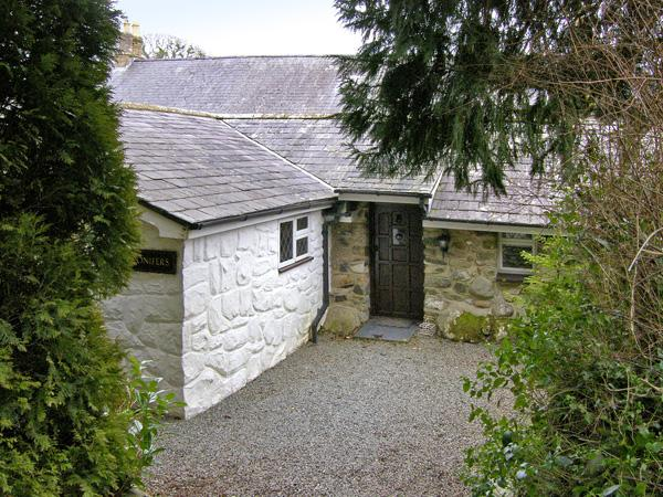 CONIFERS COTTAGE, pet friendly, character holiday cottage, with a garden in Talhenbont Hall Country Estate, Ref 380 - Image 1 - Chwilog - rentals