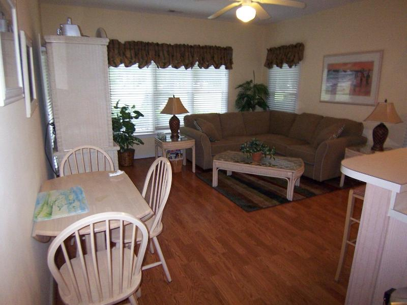 Dining table for four in downstairs living room (additional seating at bar) - 3 BR 3BA (3DV1LL2) 2 Kings 2 Qns, Sunset Beach NC - Sunset Beach - rentals