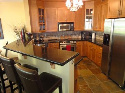 Kitchen with granite and SS appliances - Poolside Executive Condo-Waterfront (boat slip ava - Kelowna - rentals