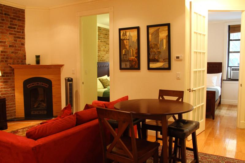 Living Room with Fireplace - East Village Luxury Three Bedroom Apartment - New York City - rentals