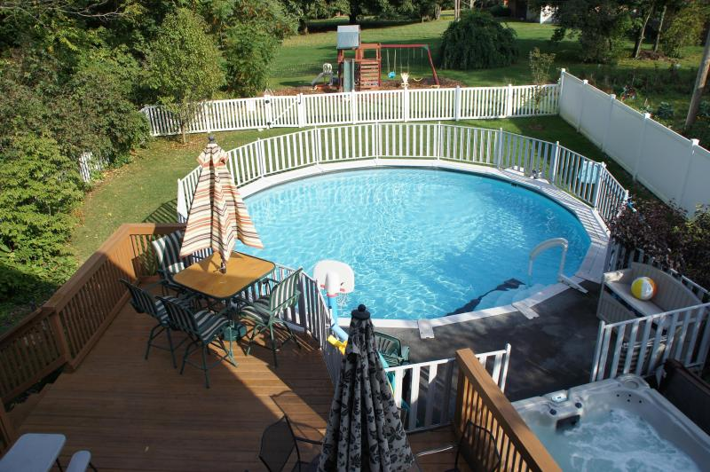 Lounge on deck overlooking the pool and hot tub.  Pool deck is gated for safety. - Sunset Center - The Ice House - South Haven - rentals