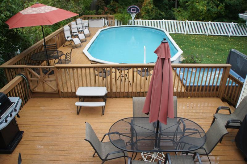 This yard has it all...large heated pool, large deck, hot tub, beautiful landscaping, and privacy. - Sunset Center - The Sun House - South Haven - rentals