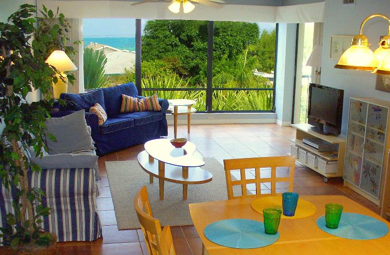 Living room with beautiful view - Ditch the Crowds – Quiet Gulf-View Condo with Pool - Holmes Beach - rentals