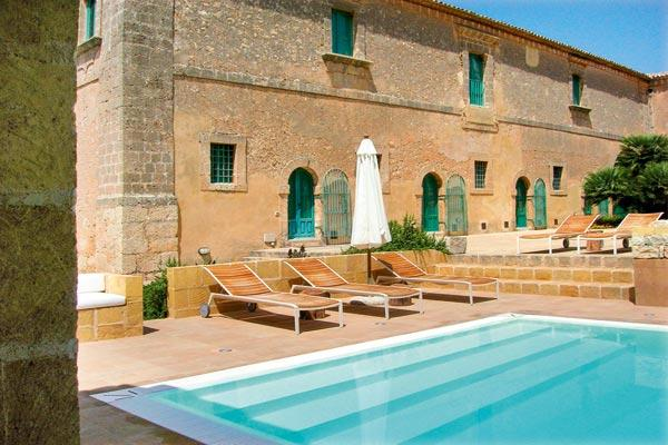 In the heart of the baroque area of southern Sicily, this newly built cottage is enhanced with traditional Mediterranean gardens. HII MIL - Image 1 - Sicily - rentals
