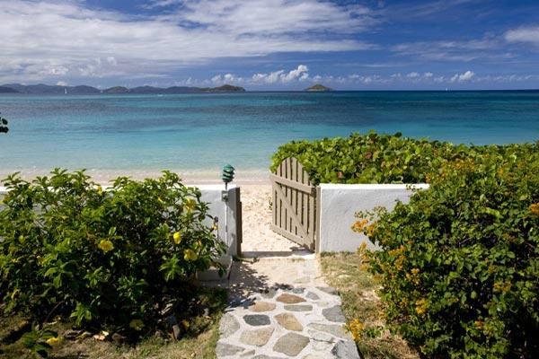 This beachfront villa is designer decorated, with a professional grade kitchen. VG BEA - Image 1 - Mahoe Bay - rentals