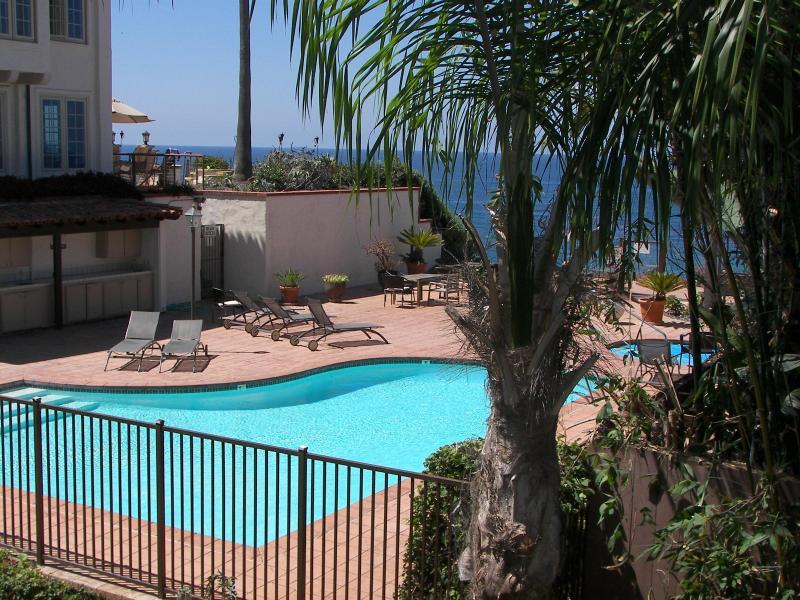 Deck Ocean View across pool and Jacuzzi deck - Beach Condo 122- Moonlight Beach, Pool, Spa, Beach - Encinitas - rentals