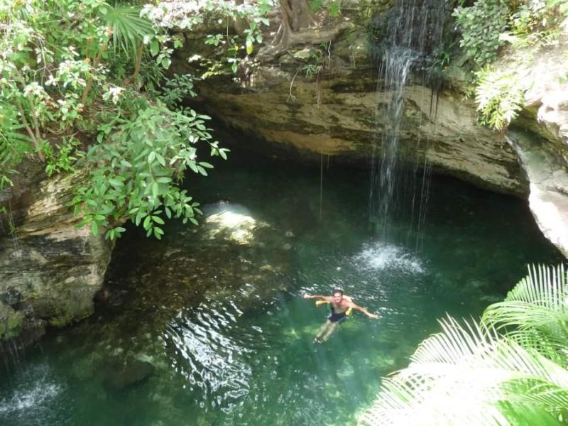 Refreshing private cenote with waterfall for swimming within condo complex - Gorgeous Beach Condo with Private Cenote - H2O - Playa del Carmen - rentals