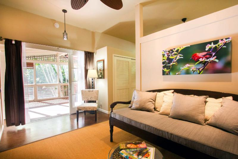 Living room looking towards the screened porch. - Ginger Falls Vacation Rental - Makawao - rentals