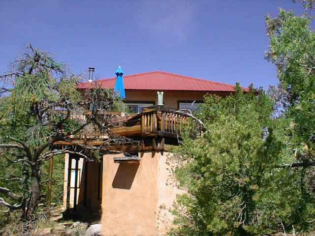 Back view of deck from the edge of the forest - Casa Cielo (House of the Heavens) - Taos - rentals
