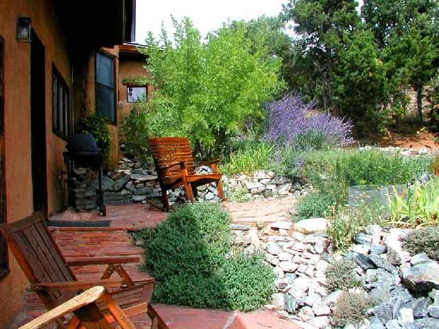 East facing patio for outdoor dining is landscaped with artful rock gardens and native southwest foilage - Casa La Ceja Main House - Taos - rentals