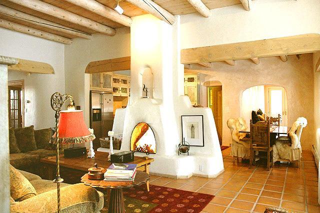 Living room wood burning kiva fireplace - Casa Miguel - Taos - rentals