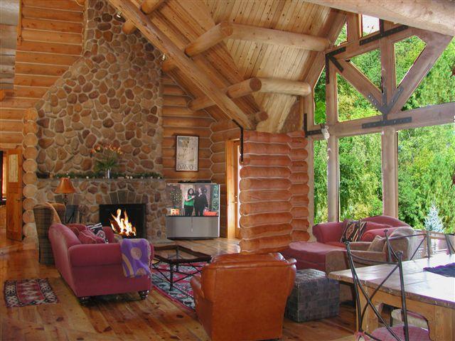 The Log Home's gracious living room - El Salto Log Home Compound - Taos - rentals