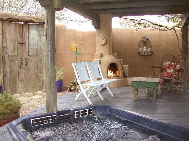 Private sunken hot tub with outdoor kiva fireplace - Hacienda de la Luna - Taos - rentals