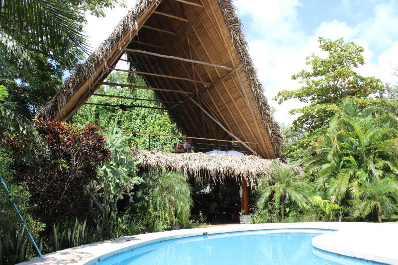 The thatched roof rancho living room is the ultimate tropical escape - Las Brisas De Nosara-- Rental House & Guest House - Nosara - rentals