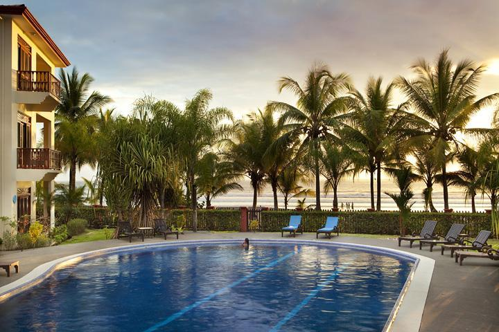 Pool and sunset at Bahia Azul - Beautiful 2 bedroom beachfront condo at Bahia Azul - Jaco - rentals