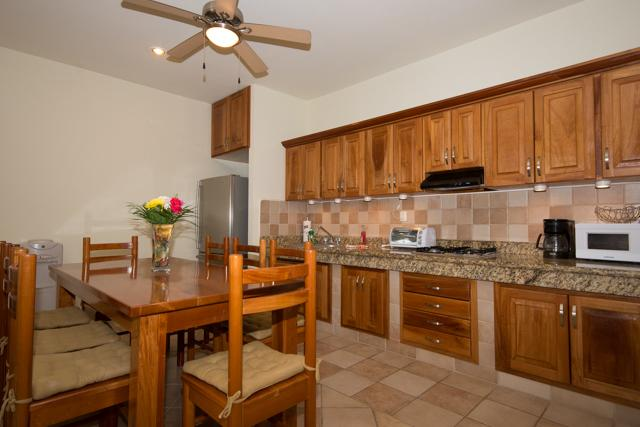 Fully equiped kitchen with granite countertop and dining table which seats up to eight people. - CONDO PLAYAINN - a hidden gem steps from Mamitas! - Playa del Carmen - rentals