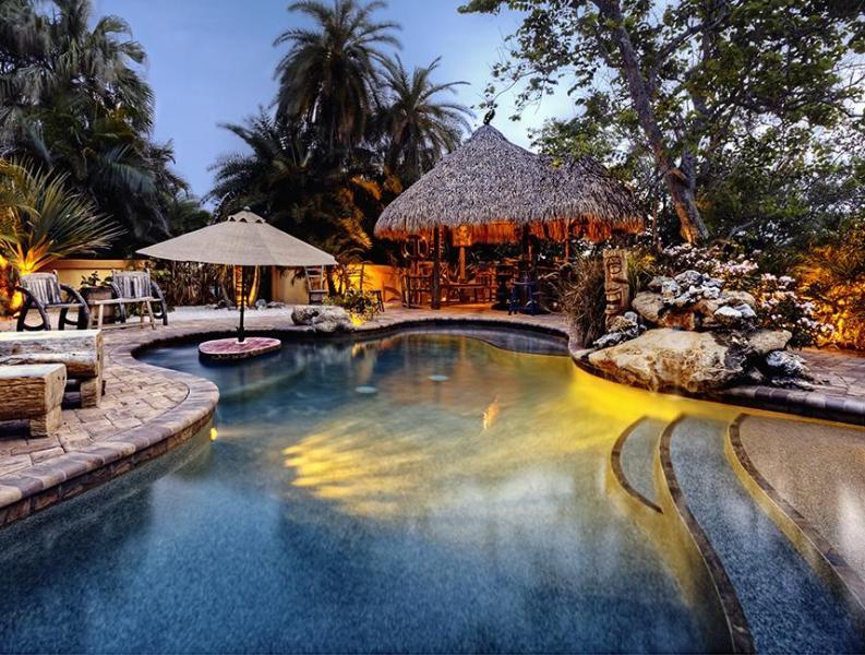Lagoon and tiki hut,waterfall,swim up table, beach entry and baja ledge - Casa Encantada.A Private Waterfront Estate - Bradenton - rentals
