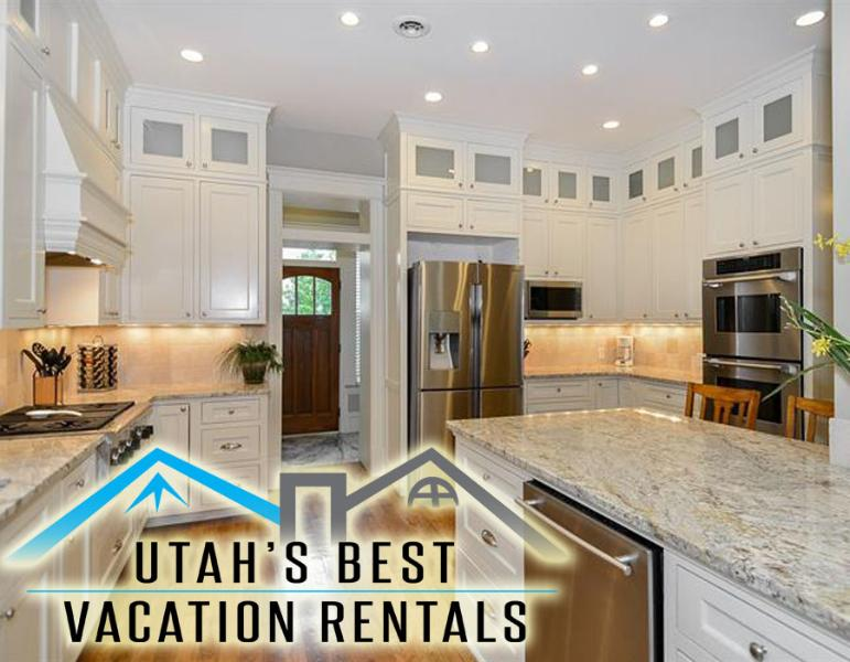 Gorgeous gourmet kitchen with granite tops, wood floors, white cabinetry, deluxe subzero appliances - 10+ Dwntwn Mansion! 4 Levels+Slp 20+Gm Rm+2 Decks - Salt Lake City - rentals
