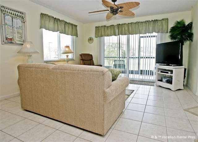 Enjoy our beautiful living room with tile floors & HDTV - Ocean Village J17, Ground Floor Unit, HDTV, Screened Lanai - Saint Augustine - rentals