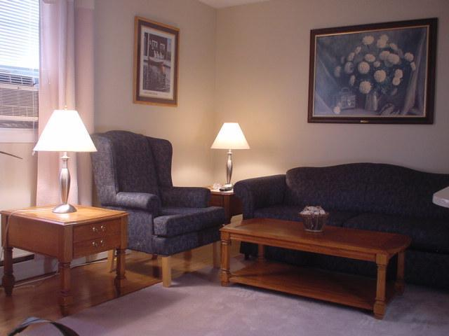 Suite 1. Living Room is Tastefully Decorated with high Wing Back Chairs and Matching Pull Out Sofa. - Executive Suite in the New Niagara Falls Canada - Niagara Falls - rentals