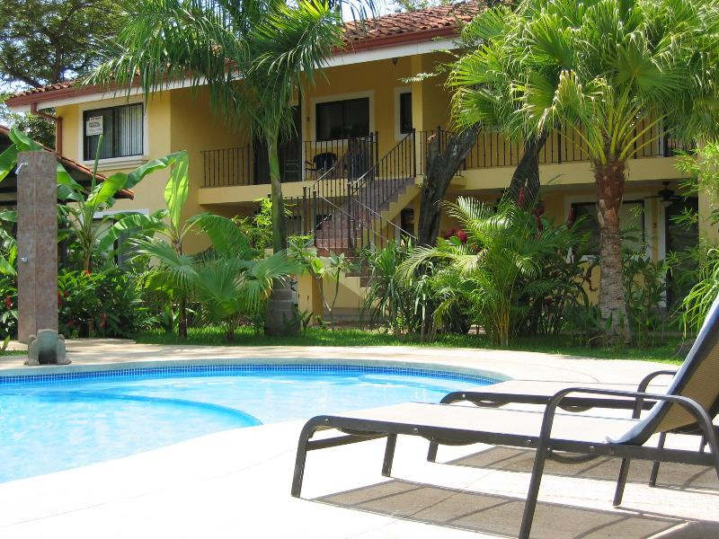 View from the pool (condo is top left) - Over 1000 sq ft Condo Near Beach and Attractions! - Playas del Coco - rentals