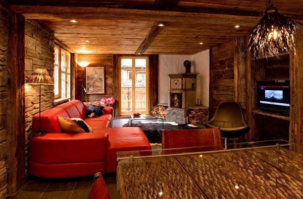 Living room with antique stone fire-stove - Chalet Heidi - central & traditional Swiss feeling - Zermatt - rentals
