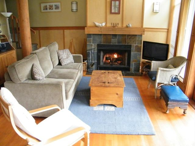 Living Room with wood burning fireplace - Tofino Waves Vacation Home on Chesterman Beach - Tofino - rentals