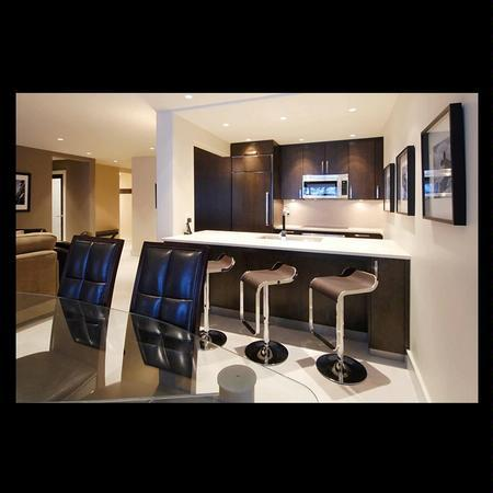 Modern kitchen with an open concept design. High end appliances including Bosch and Zub Zero, heated flooring and Corian countertops. - Ultra Luxury 4 Bedroom Ski In/Ski Out at Whistler's Blackcomb Mountain - Whistler - rentals
