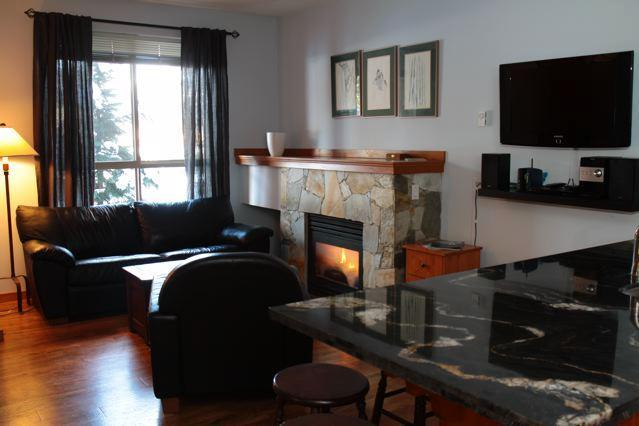 The cozy Living Area, complete with fireplace! - Forest.directVacations.com - Whistler - rentals
