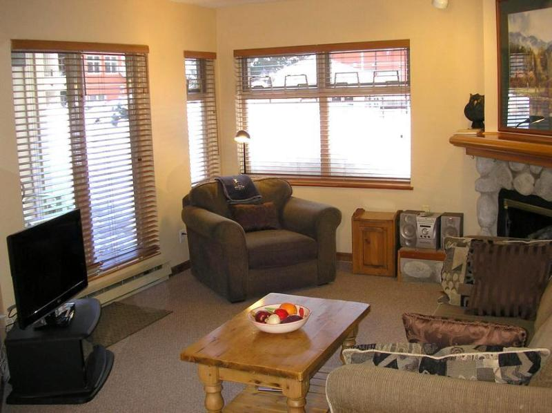 A warm comfortable living room. To the left is the patio door which leads onto the private deck. Just 50 feet from the deck is the pool and hot tub. - 1 br ski in/ski out condo with free WI-FI & hot tub/pool - Whistler - rentals